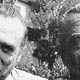 Photo of Charles Bukowski with the clay bust sculpted by Linda King