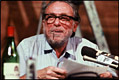 Photo of Charles Bukowski reading at the Sweetwater, 1980